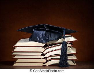 libros, gorra, graduación, abierto