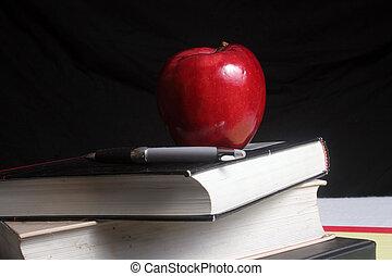 libros, manzana
