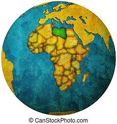 libya territory with flag on map of globe