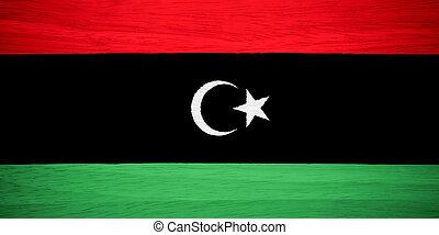 Libya flag on wood texture
