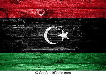 Libya flag on wooden planks background