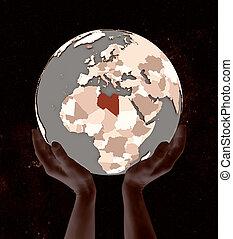 Libya on globe in hands