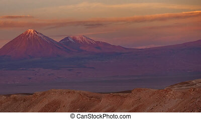 Licancabur volcano time lapse with full moonrise at sunset...