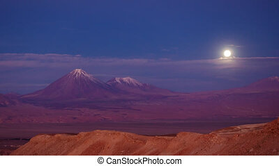 Licancabur volcano time lapse with full moonrise over the...