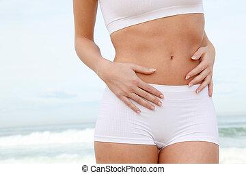 lichaam, strand, stretching, closeup, van een vrouw