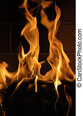 Licking Flames - A newly lit fire roars in a fireplace, the ...