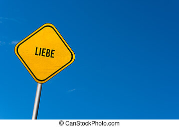 liebe - yellow sign with blue sky