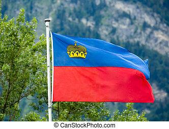 Liechtenstein flag waving on mountain background - ...
