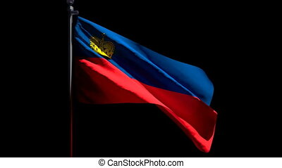 Liechtenstein's national flag flutters in the wind against a black background