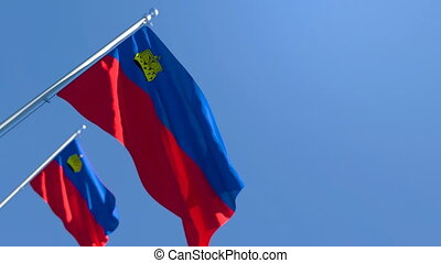 Liechtenstein's national flag flutters in the wind against a blue sky