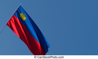 Liechtenstein's national flag flutters in the wind
