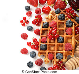 Liege waffles with berries on white background