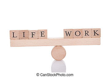 Life And Work Blocks Balancing On Seesaw