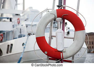 Life belt, passenger ship in the background - Life belt and...