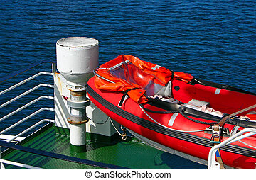 Life Boat on a Ferry - Red open lifeboat on a ferry boat