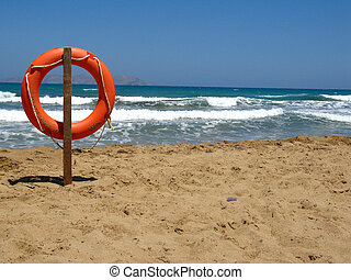 Life bouy and sea - Life bouy in the empty beach of Crete, ...