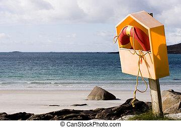 Life buoy at the seaside - Life saver along the seashore.