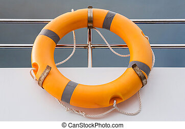 Life buoy - Orange life buoy in boat