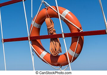 Life buoy ring on ship against blue sky.