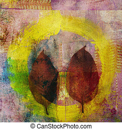 2 abstract leaves with a yellow painted circle or enso.