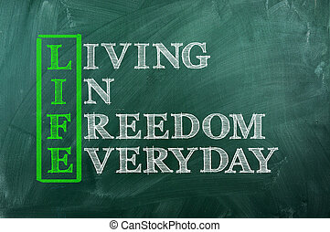 Acronym concept of Life and other releated words on green chalkboard