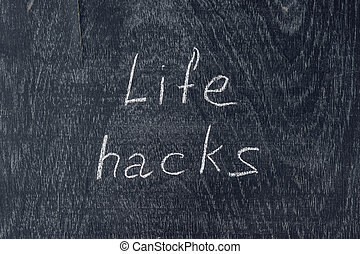 life hacks written on the blackboard using chalk