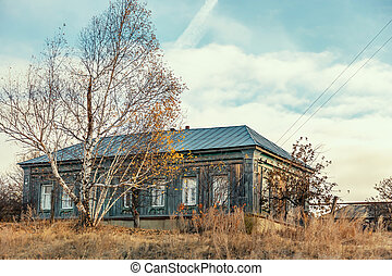 Life in the countryside, housing for self-isolation in quarantine, one lonely suburban wooden secluded house in Russia in the Saratov region in isolation period