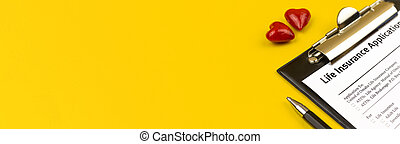 Life insurance form. Banner photo. Clipboard with agreement, pen and red heart on a yellow desktop. Top view