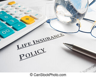 life insurance policy on the desk.