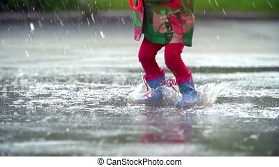 Life is an Attitude - Tilt up of little girl bouncing and...