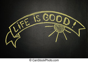 Life is good with Ribbon Banner, written with chalk on a blackboard