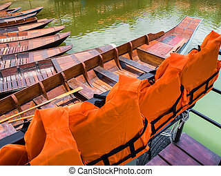 Life jacket for passengers of boat trip in the lake