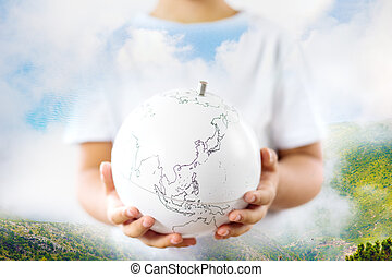 Life on earth - environment and ecology concept double exposure earth globe in child hands