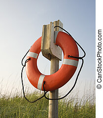 Life preserver hanging on post. - Life preserver hanging on...