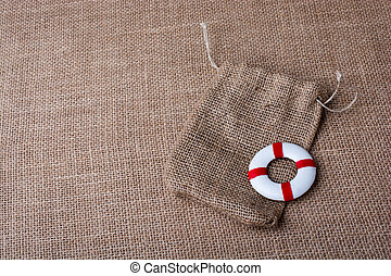 Life preserver on a sack on canvas