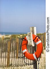 Life preserver on beach.