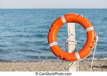 Life preserver on sandy beach