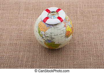 Life preserver on top of globe