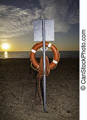 Life saver buoyancy aid at sunrise - Clear view of a...