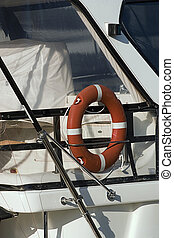 Life-Saver - Red life preserver onboard luxury boat