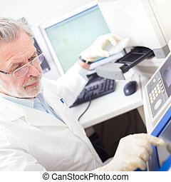 Life scientist researching in the laboratory. - Life science...