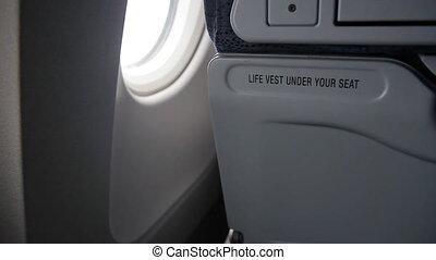 Life vest under your seat. 2 shots.