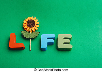 Life wording with the help of a fake flower