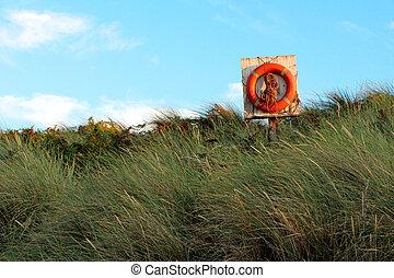 Lifebelt on the Dunstanburgh coast