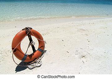 Lifebuoy - A view of a lifebuoy on the beach