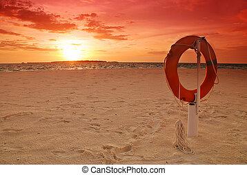 Lifebuoy and sunset
