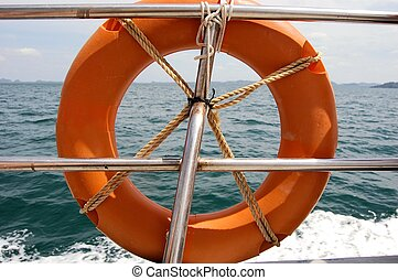 Lifebuoy attached to boat in blue sea