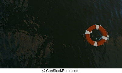 Lifebuoy Floating on Sea and Sharks Swimming, zoom out
