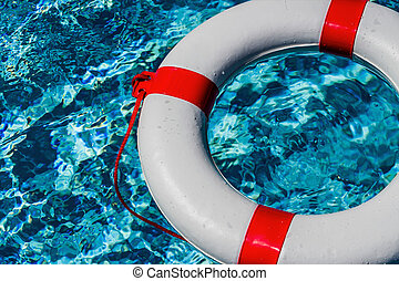 lifebuoy in a pool - an emergency tire floating in a pool. ...