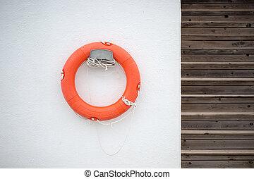 Lifebuoy on a white wall